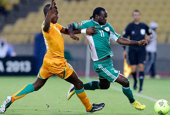 Nigeria's Victor Moses (right) fights for the ball with Ivory Coast's Salomon Kalou in Nigeria's semifinal win.
