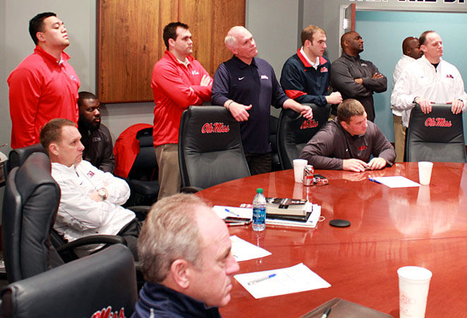 Ole Miss coaches watch as heralded defensive end Robert Nkemdiche announces his college destination.