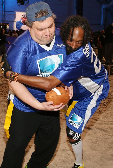 Wrassling for the last stuffed pigskin at DIRECTV'S Seventh Annual Celebrity Beach Bowl in New Orleans.