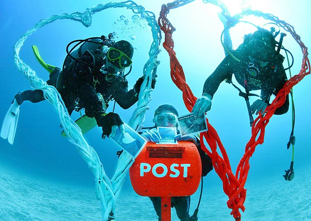 If you've ever wished your significant other were on the bottom of the ocean instead of making your life a complete misery, and then had a dramatic change of heart, there's a mail box 19 feet under the sea off the coast of Ito, Shizuoka prefecture, Japan where you can deposit a conciliatory valentine just like these divers are doing.
