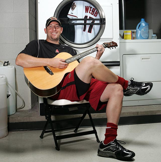 The starting pitcher plays guitar in a laundry room in Phoenix, AZ, on Sept. 5, 2009.