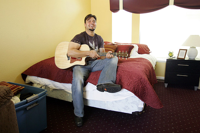 The outfielder and first baseman plays guitar on bed at home in Blackhawk, CA, on May 29, 2007.