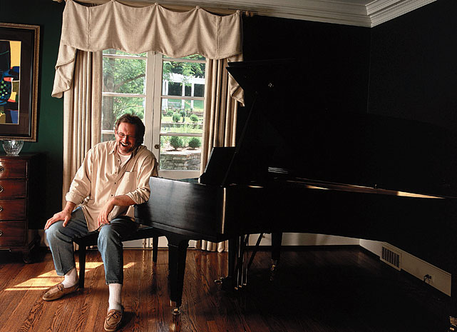 The retired defensive tackle sits at home in front of his piano on June 15, 2001 in Nashville, TN.