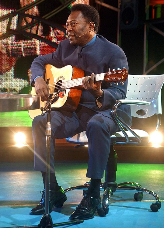 "The soccer legend plays guitar as he sings, during the premiere of Maradona's TV show called ""La noche del 10"" in Buenos Aires on Aug. 15, 2005."