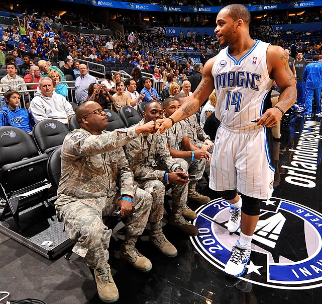 Jameer Nelson bumps fists with a member of the Armed Forces during Seats for Soldiers night before a game against the Toronto Raptors in 2010.