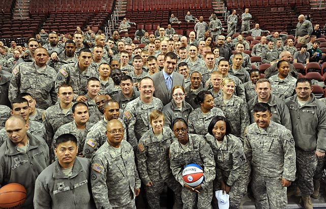 76ers center Spencer Hawes poses with soldiers after a 2010 game against the Nets.