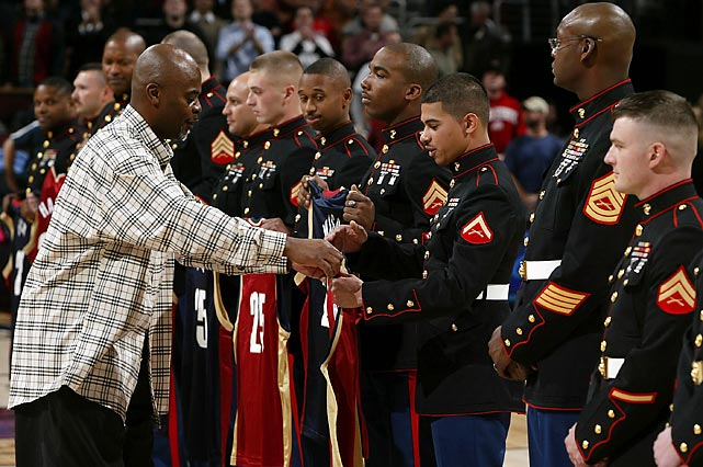 Cavaliers legend Sedric Toney presents replica jerseys to members of the 3rd Battalion, 25th Marines during a halftime presentation in 2006.