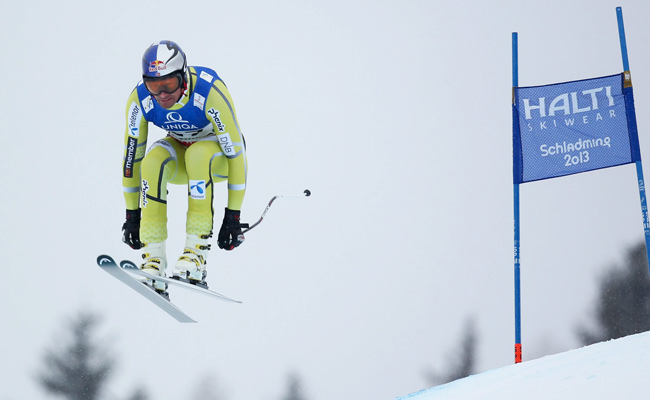 Aksel Lund Svindal kept a near-perfect line down the icy and bumpy course despite foggy conditions
