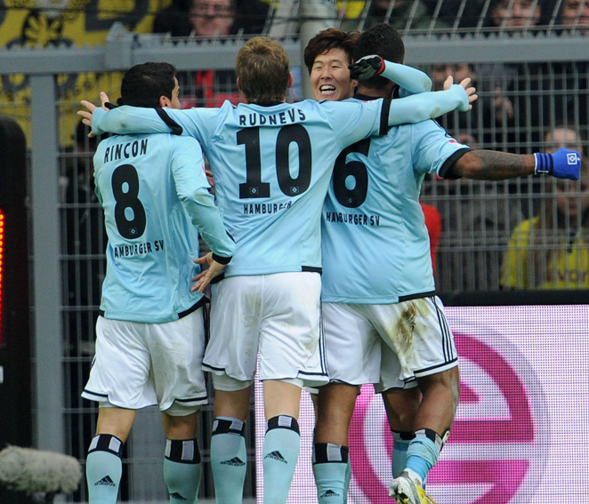 Hamburger SV celebrates one of its four goals in its unexpected 4-1 victory over Borussia Dortmund.