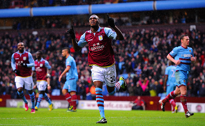 Christian Benteke celebrates his penalty kick that gave Aston Villa a 1-0 lead.