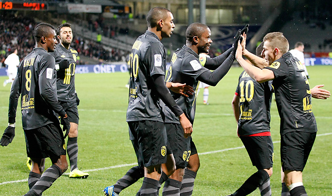 Aurelien Chedjou (second from right) of Lille celebrates with teammates after scoring the first goal.