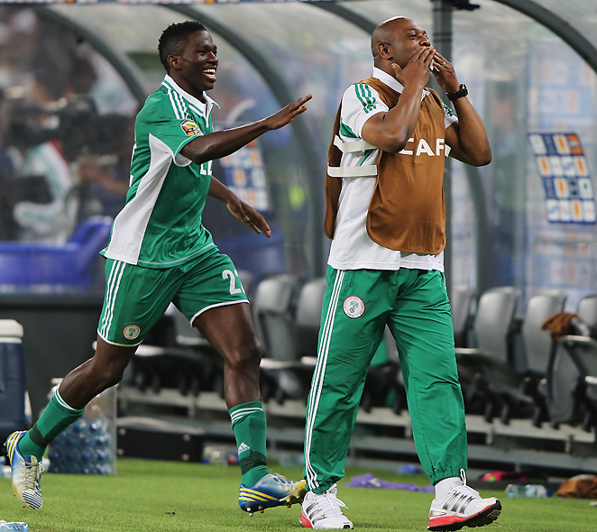 Stephen Keshi, here celebrating with defender Kenneth Omeruo, became only the second person in history to win the Africa Cup of Nations as both a coach and as a player.