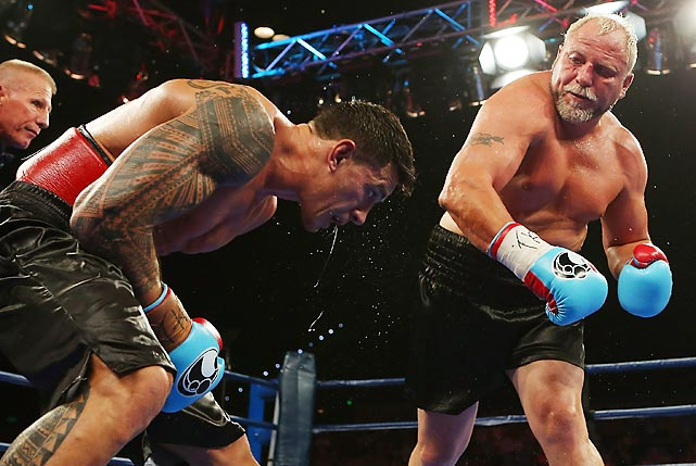 Francois Botha punches Sonny Bill Williams during their heavyweight bout in Brisbane, Australia on Feb. 8. Williams won the fight by unanimous decision but not without controversy over the length of the bout and the drug-testing procedure.
