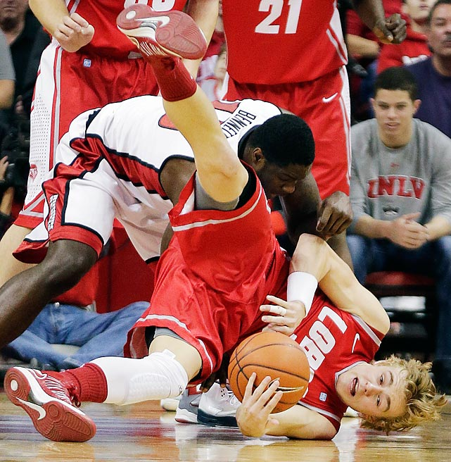 New Mexico guard Hugh Greenwood dives for a loose ball to take it away from UNLV forward Anthony Bennett in the first half of a Mountain West Conference matchup on Feb. 9. Led by Bennett's 17 points, the Runnin' Rebels upset the 15th-ranked Lobos 64-55.