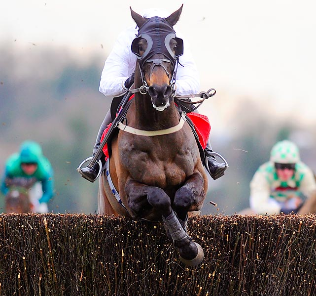 Gemma Gracey-Davison, riding Nozic, clears the last obstacle to win the Racing Plus Chase Day at Kempton racecourse on Feb. 8 in Sunbury, England.
