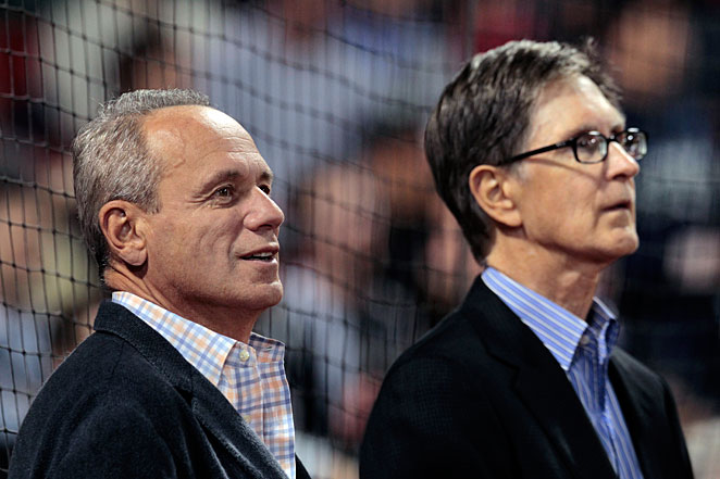 John Henry (right) has said he and Larry Lucchino (left) and Tom Werner (not pictured) are committed to keeping the Red Sox.