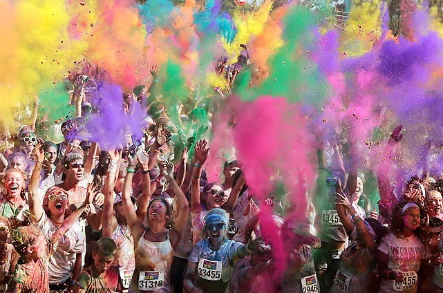 Participants celebrate in clouds of colored dust after completing the Swiss Color Run in Sydney Australia on Feb. 10. In the Color Run, a 5K race, runners pass through a color station each kilometer and get covered with colored powder.