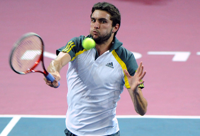 Gilles Simon broke Daniel Brands once to take the second set and wrapped up the match in 92 minutes.