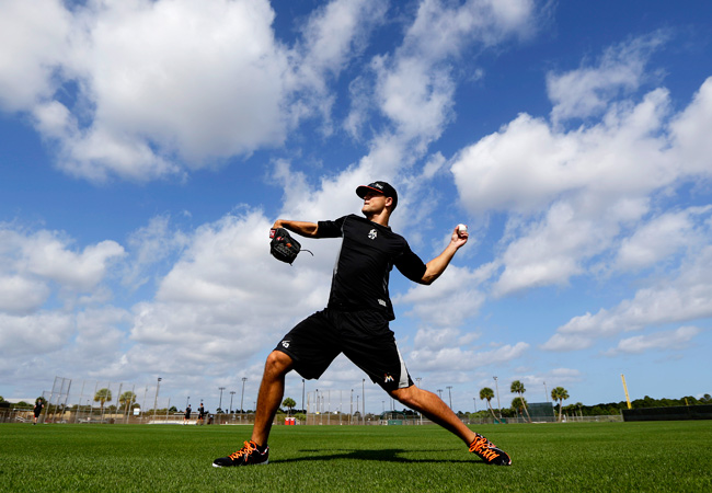 Miami Marlins pitcher Dan Jennings throws a ball before the official start of spring training baseball.
