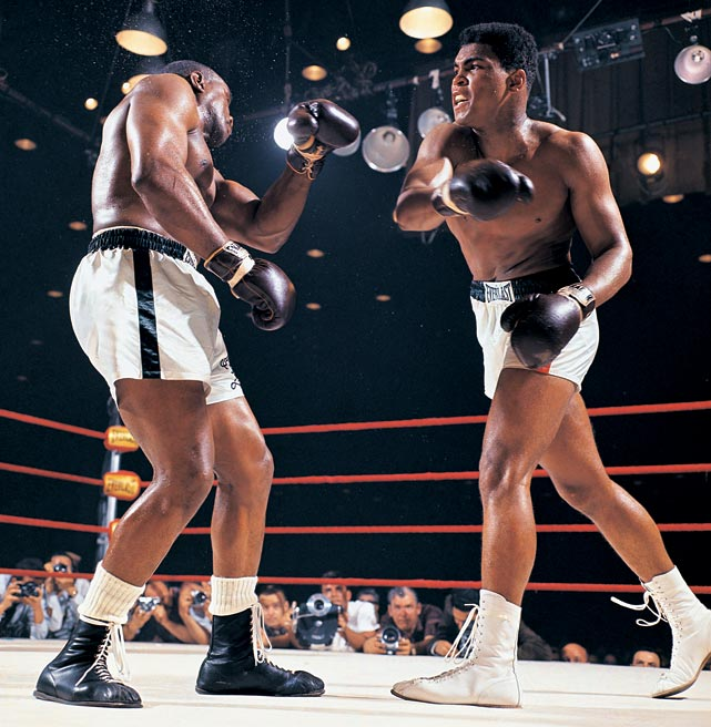 Liston, one of the most feared heavyweight champions in history, was a 7-1 favorite over the young challenger known as the Louisville Lip. But Ali, here stinging the champ with a right, used his dazzling speed and constant movement to dominate the action and pile up points. Battered and discouraged, Liston would quit on his stool before the start of the seventh round, and Ali, at 22, would become the new champ. Click here for Neil Leifer's fine art photography.