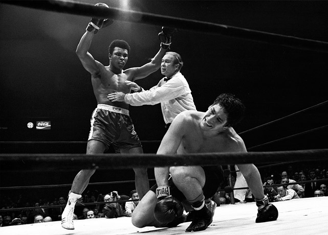 In his first comeback bout, Ali stopped Jerry Quarry in three rounds. Two months later he took on the rugged Argentine contender Bonavena in Madison Square Garden. After a long, often sloppy bout, Ali?here being held back by referee Mark Conn?produced one of the most dramatic finishes of his career, dropping Bonavena three times in the 15th and final round to automatically end the fight. The win cleared the way for a showdown with Joe Frazier, the man who had taken the heavyweight title in Ali's absence. Click here for Neil Leifer's fine art photography.