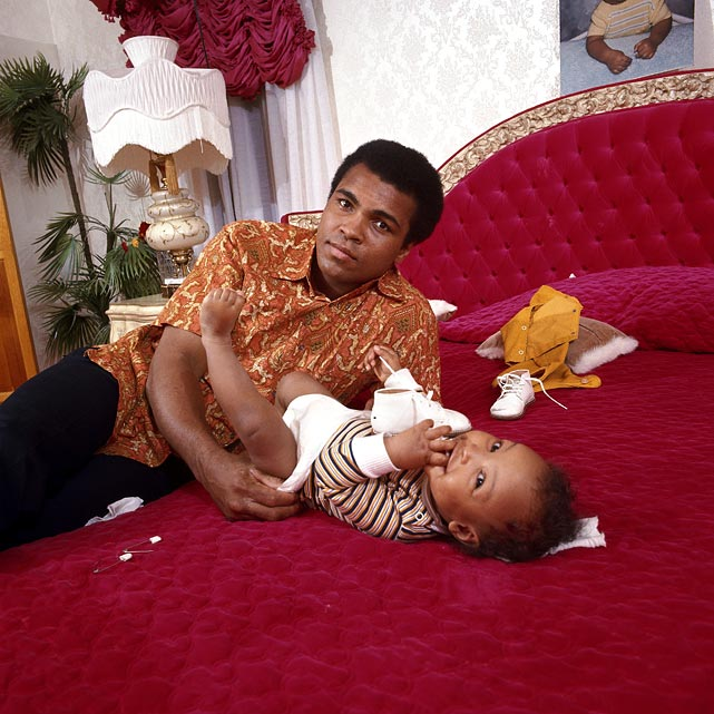 Ali changed the diaper of his son Ibn Muhammad Ali Jr. in his bedroom during a photo shoot at the family's home in April 1973. Ali had suffered a broken jaw less than a month earlier in his fight against Ken Norton. Click here for Neil Leifer's fine art photography.