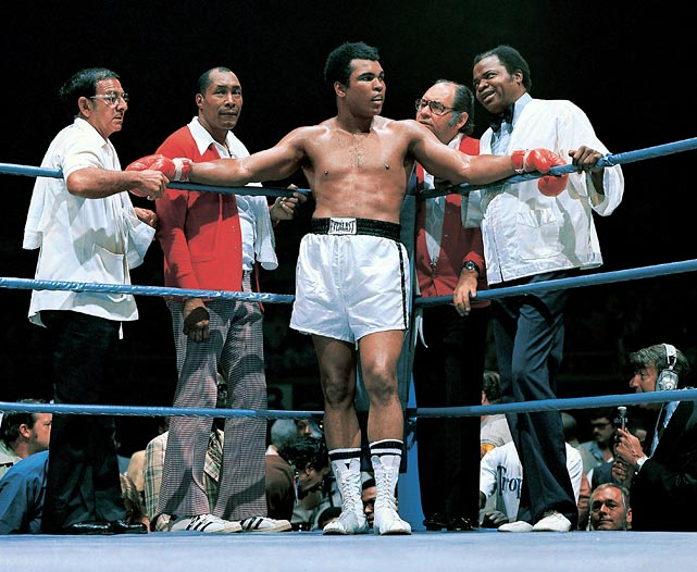 The men behind The Man: Ali stands with (from left) trainer Angelo Dundee, assistant trainer Wali Muhammad, physician Dr. Ferdie Pacheco and assistant trainer Drew Bundini Brown before his bout with Ron Lyle in May 1975. Ali won the fight by technical knockout in the 11th round. Click here for Neil Leifer's fine art photography.