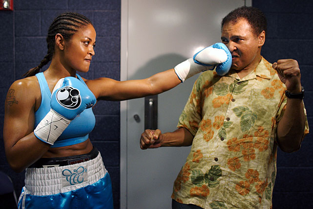 Like father, like daughter. Ali absorbed a loving left in this, presumably, posed shot before Laila's fight against Erin Toughill in 2005. Unlike her old man, Laila would retire undefeated, ending her career with a professional record of 24-0. Click here for Neil Leifer's fine art photography.