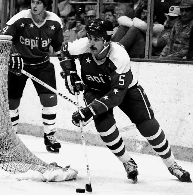 "The OHA's Most Outstanding Defenseman award for 1975-76 was taken by the Capitals ahead of scoring winger Blair Chapman (Penguins). A 6'-3"", 200-pound defensive blueliner, Green was enlisted to help keep the puck out of the leaky Caps' net. His rookie season was cut short by a broken wrist, but he became a workhorse, though one that logged unsightly ratings of -35 and -46 while drawing frequent boos. He eventually won Caps fans over, but after six seasons in Washington, he was dealt to Montreal in the Rod Langway trade and ended up winning the Stanley Cup with the Canadiens in 1986. He also helped them reach the '89 final. After a season with the Red Wings and a brief hitch as an Islander, Green retired in 1992, having played 845 games."