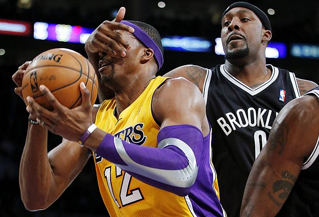 "That's not a game of ""Guess Who"" Brooklyn's Andray Blatche is playing with Dwight Howard of the Lakers."