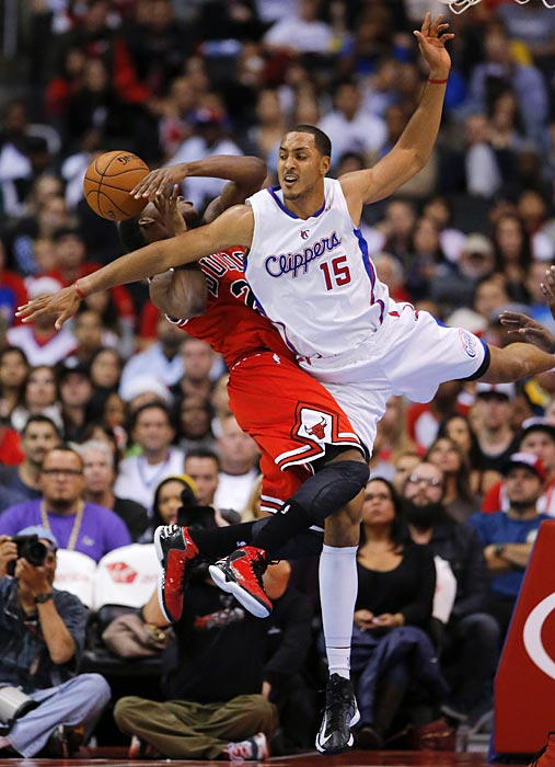 Ryan Hollins of the Clippers put his full body into this foul on Jimmy Butler of the Bulls.