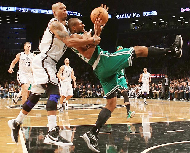 Keith Bogans of the Brooklyn Nets hauls down Boston's Leandro Barbosa to prevent an and-one.