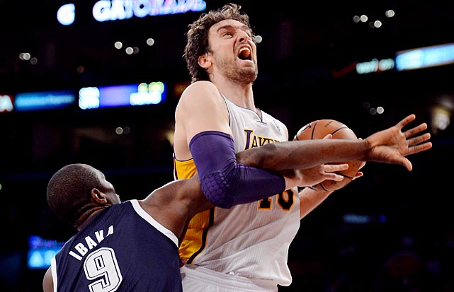 Pau Gasol of the Lakers tries to power through a foul by Serge Ibaka of the Oklahoma City Thunder.