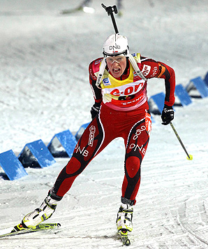 Norway's Tora Berger shot perfectly in the snowy conditions to take her third gold medal of the world championships.