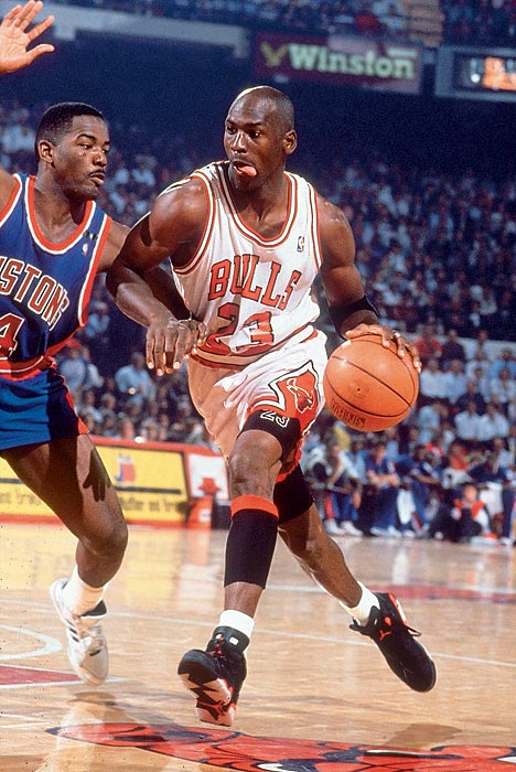 Jordan drives on the Detroit Pistons' Joe Dumars in Game 2 of the 1991 Eastern Conference Finals. Jordan dropped 35 points in the Bulls' win, the second of four straight to finally oust the Pistons in the playoffs after Detroit eliminated them in each of the two prior seasons.