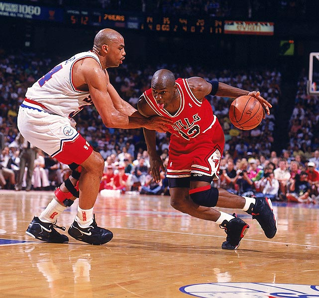 Jordan tries to drive past Barkley in 1991. Jordan said he didn't consciously stick his tongue out while playing and even told kids not to do it out of fear they might accidentally bite theirs.