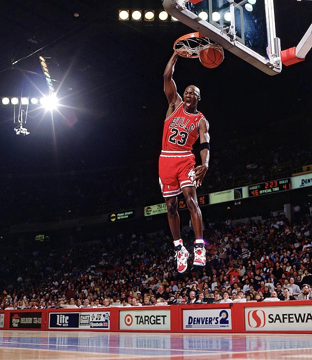 Jordan finishes off a fast break with an emphatic slam dunk against the Denver Nuggets in November 1991. Jordan scored 38 points with 12 assists and seven rebounds in a wild 151-145, come-from-behind win.