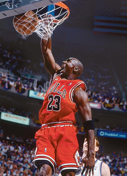 Michael Jordan throws down a dunk in the second half of Game 2 of the 1998 NBA Finals against the Utah Jazz. After dropping game 1 of the series, the Bulls rattled off three straight wins to take control of the Finals and win the championship in six games.