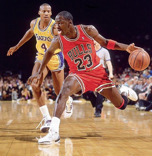 Jordan fakes on a drive against the Los Angeles Lakers in February 1988. Jordan won his first MVP Award that season, averaging 35.0 points, 5.9 assists, 5.5 rebounds, 3.2 steals and 1.6 blocks. Those final two stats helped Jordan claim Defensive Player of the Year.