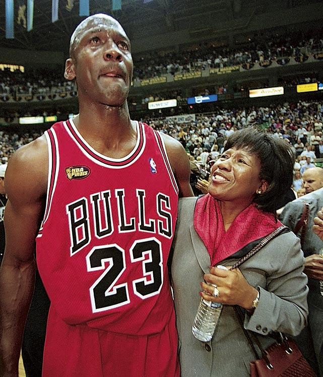 Jordan wraps his arm around his mother, Deloris, after defeating the Utah Jazz in Game 6 of the 1998 NBA Finals to wrap up his sixth championship. In the final 41.9 seconds, Jordan made a layup, stole the ball from Karl Malone and hit a game-winning jumper from the top of the key to bring the Bulls back from a three-point deficit.