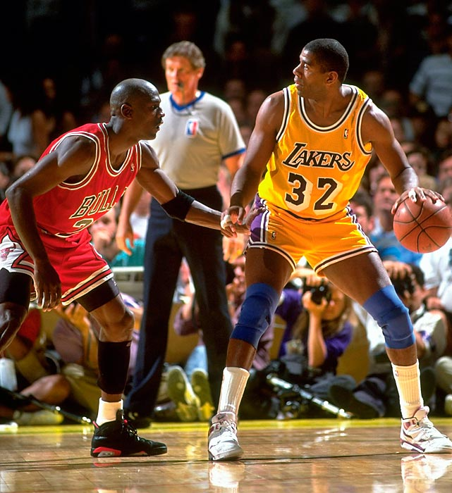 Magic Johnson works against Jordan during Game 5 of the 1991 NBA Finals. Jordan dropped 30 points and dished out 10 assists to secure his first NBA title.