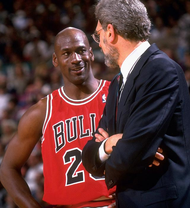 Jordan talks with Bulls coach Phil Jackson on the sideline during Game 4 of the Eastern Conference semifinals against the New York Knicks in 1996. Coming off a record 72-10 regular season, the Bulls lost just three games in the postseason as Jordan claimed another championship in his first full season back from retirement.