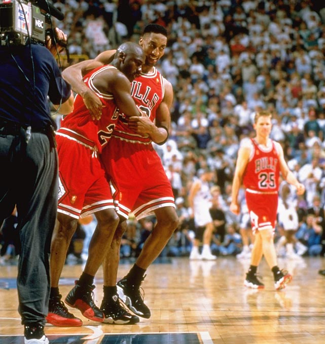 Scottie Pippen helps an exhausted and sick Jordan off the floor after Game 5 of the 1997 NBA Finals. Jordan played through a stomach virus to score 38 points, hitting a three to put the Bulls ahead for good with 25 seconds remaining. In the final seconds of the game, Jordan collapsed into Pippen's arms.
