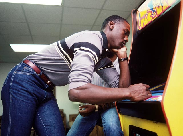 Jordan plays Ms. Pac Man at North Carolina in November 1983. Already a first-team All-America from his sophomore season, Jordan topped that by winning the 1984 John Wooden Award as a junior before declaring for the NBA Draft.