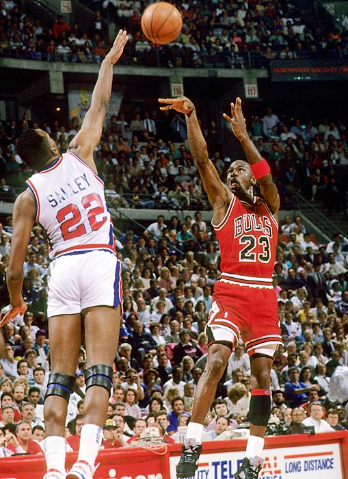 Jordan puts up a shot over the outstretched arm of Detroit's John Salley in Game 2 of the 1990 Eastern Conference Finals. Despite four games with 31 or more points, Jordan was unable to keep the Pistons from eliminating the Bulls in the conference finals for the second consecutive season.