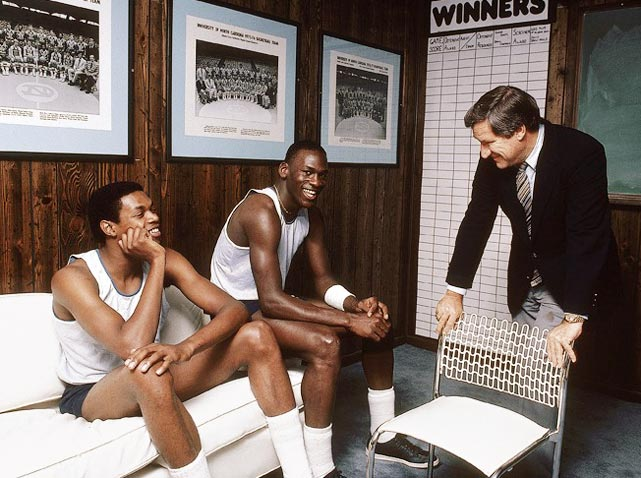Jordan and Sam Perkins sit on the couch in coach Dean Smith's office at North Carolina in November 1983. Smith won the first national championship of his Hall of Fame coaching career with Jordan and Perkins in 1982.