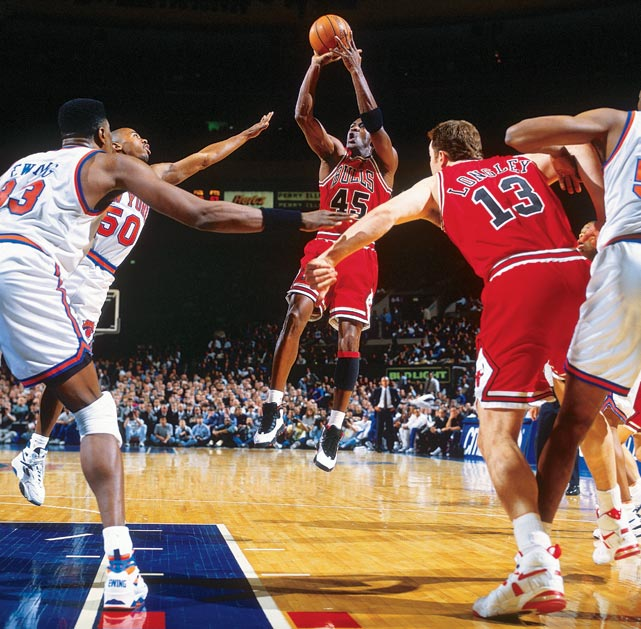 Jordan knocks down a jumper against the New York Knicks at Madison Square Garden in March 1995. Just five games after returning from his first retirement, Jordan scored 55 points as the Bulls held off the Knicks 113-111.