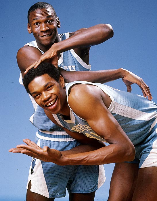 Jordan rubs the head of Sam Perkins for a portrait in November 1983. The Tar Heels went undefeated in the ACC during the regular season but lost in the ACC Tournament and was upset in the Sweet 16 by Indiana.
