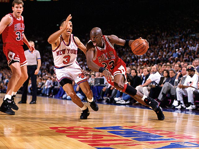 Jordan drives against the New York Knicks in the 1993 NBA Playoffs. After winning a third straight NBA title, Jordan stunningly retired from basketball, saying he had lost his desire to play.
