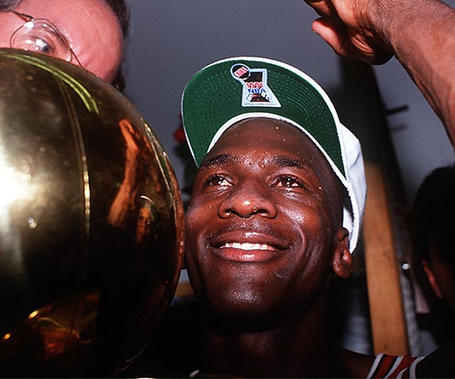 Jordan smiles after bringing home the first NBA title of his career in 1991. After losing to the Detroit Pistons in the Eastern Conference Finals the two years prior, the Bulls swept Detroit and then defeated the Lakers in five games for the first championship in franchise history. He cried after receiving the trophy.